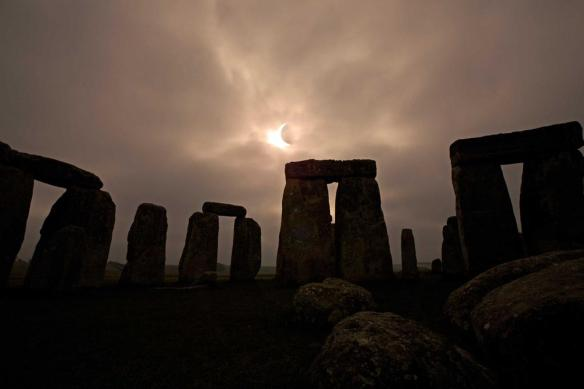Photo of partial solar eclipse over Stonehenge by English Heritage