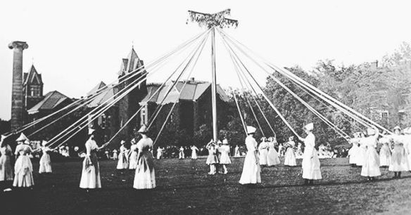 Black and white photo of May Day celebration around a Maypole